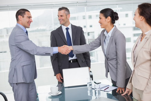 Cheerful businesspeople shaking hands - San Diego Airport Limo Service