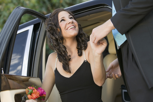 Smiling girl stepping out of a car - San Diego Car Service