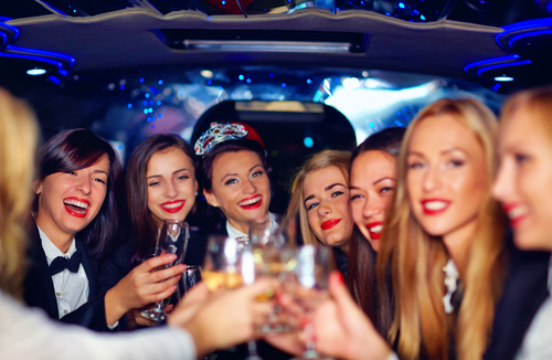 Women drinking champagne in a limo -San Diego car Service