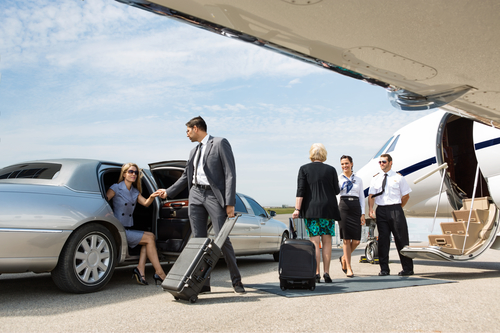 Business people about to board a private jet - San Diego Airport Sedan