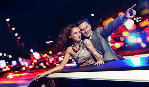 Elegant couple in limo at night
