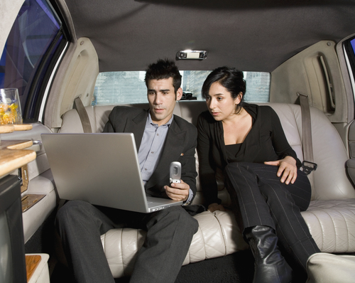 Businesspeople Working in Limo - Transportation fro LAX to San Diego Airport