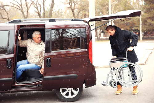 How do I safely transport a disabled or elderly person