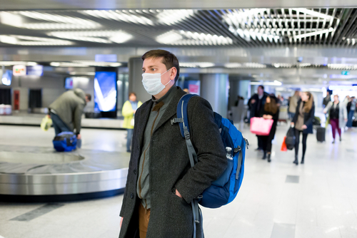Should I wear a medical mask while traveling
